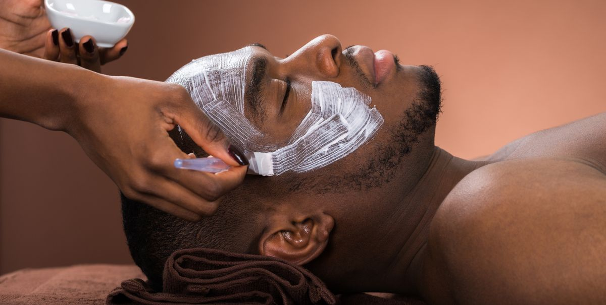 therapist-applying-face-mask-to-man-royalty-free-image-609094134-1547225313